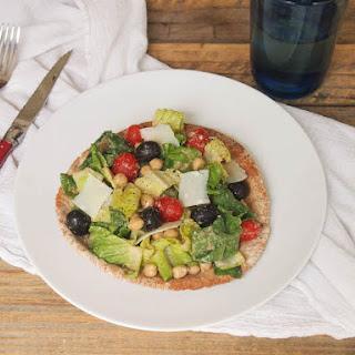 Caesar Salad Pita Pizza with Olive Caesar Dressing.
