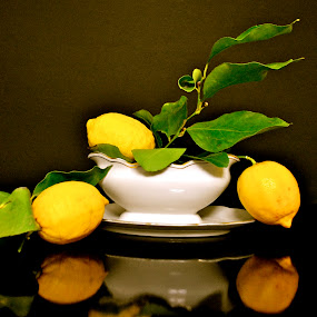 by Anisja Rossi-Ungaro - Artistic Objects Still Life ( fruit, green leaves, dark, yellow, light )