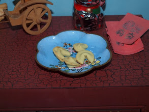 Photo: Polymer clay fortune cookies and red envelopes.