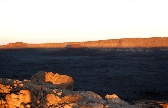 Photo: ... lighting up the opposite side of the vast caldera from the tips of the 1949 and 1940 cones at the southern end...