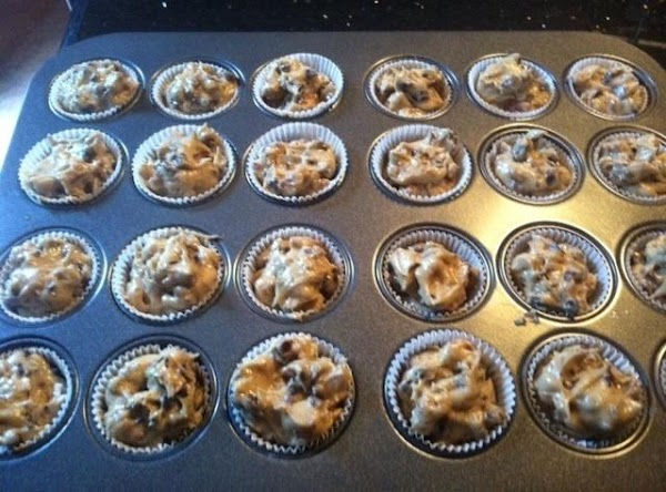 PLACE A HEAVY TEASPOON OF COOKIE BATTER INTO EACH PAPER LINED MUFFIN TIN. BAKE...