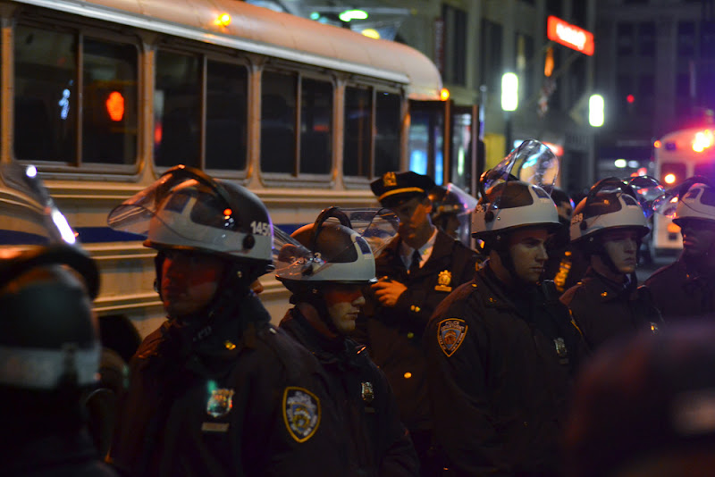 Photo: Arrestee buses and garbage trucks streamed down Broadway.