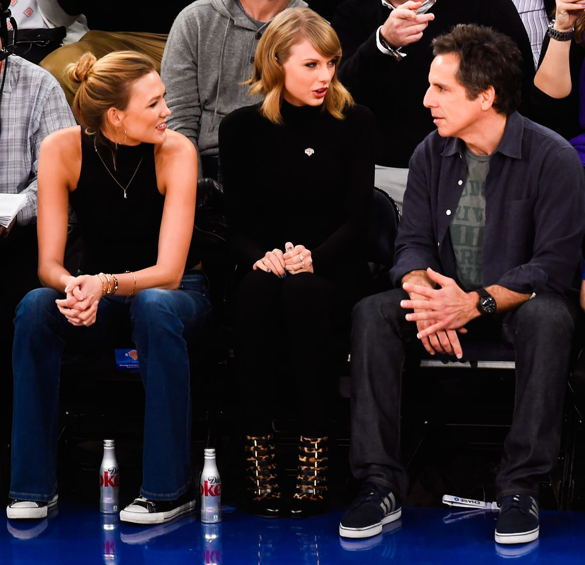 NEW YORK, NY - OCTOBER 29: Taylor Swift sits next to Karlie Kloss and Ben Stiller during a game between the New York Knicks and Chicago Bulls at Madison Square Garden on October 29, 2014 in New York City. NOTE TO USER: User expressly acknowledges and agrees that, by downloading and/or using this photograph, user is consenting to the terms and conditions of the Getty Images License Agreement. (Photo by Alex Goodlett/Getty Images)