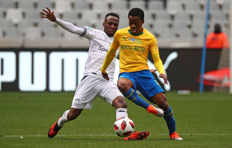 Mamelodi Sundowns midfielder Siphelele Mkhulise tussle for the ball with Teko Modise of Cape Town City during the MTN8 first leg semifinal at Cape Town Stadium, Cape Town on August 25 2018.