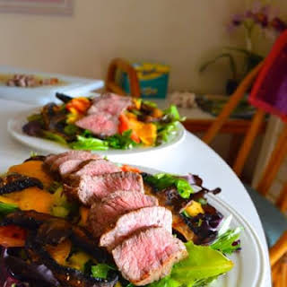GRILLED STEAK AND PORTOBELLO SALAD WITH MANGO LIME DRESSING.