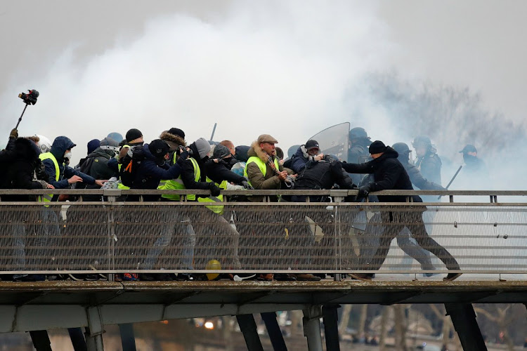 Former French boxing champion Christophe Dettinger clashes with gendarmes at a demonstration by the 'yellow vests' in Paris.