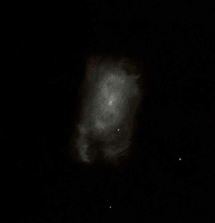 """Photo: NGC 4449, galaxie des Chiens de Chasse. Le """"S"""" centré sur le noyau, ainsi que les zones HII formant le crochet du bas sont perçus assez facilement. Au T406 à 220X, NATs mai 2018."""