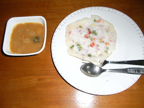 Photo: Uttapam, Indian Pancakes made of the batter mixture of Urad dal and rice, fermented for about a half day (or one night), is a favorite breakfast option for Maharastrian people. Chopped onion, tomato and green chili are typical ingredients to be mixed. Photo shows the mouth-watering Utappam and Sambar (South Indian sour beans stew) cooked by my husband in the middle of this summer. 31st July updated - http://jp.asksiddhi.in/daily_detail.php?id=256