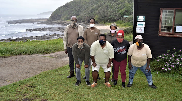 Double Mouth Camp and Caravan Park Site manager Xolani Xolo, front second from left, leads a proud little team. They are, back from left, Wiseman Ndonyana, Ubuntu Madikizela and Nomawhetu Somjwanxa and, front from left, James Mbodamo, Xolani, Vuyiso Mbem and Thabiso Baartman