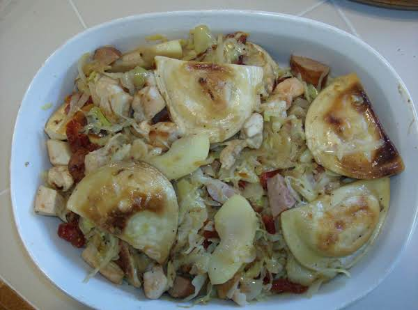 Baked Pierogies With Cabbage, Onions, Apple, Chicken, And Smoked Sausage