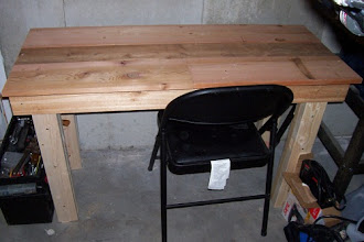 """Photo: Over the weekend, I managed to build a table for my torch! I didn't really have a good plan for building the table and kind of winged it as I went along. It measures about 1.5' x 4' and is around 28"""" high. It's a very sturdy table (hey...it holds me!) and is almost perfectly level. I had a few issues with all four legs not touching the floor at once, but this was due to the pine studs being slightly warped. I purchased some adjustable table feet last night and will screw into the the bottom of the legs. All that's left to do is to paint the table brown and afix the galvanized steel to the top. :)"""