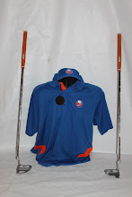 Photo: Four! Islanders visor, polo, and Islanders putters. Each sold separately.
