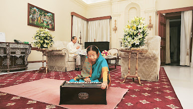 Photo: President Pratibha Patil playing classical instrument called  Harmonium her husband  Divisingh Shekhawat also seen in the background. Indian Express Photo.