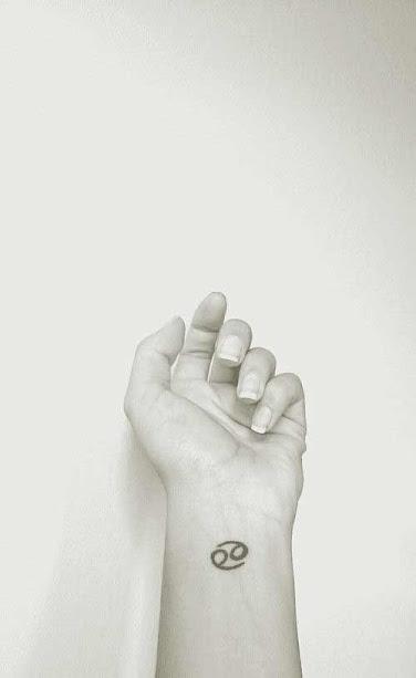cancer zodiac tattoos design on wrist