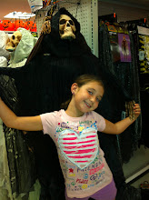 Photo: My little Diva had to pose with all the scary creatures.