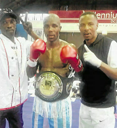 Mziwoxolo Ndwayana celebrates his SA welterweight title victory with his new trainer Lunga Sikonyela after beating Sean Ness.