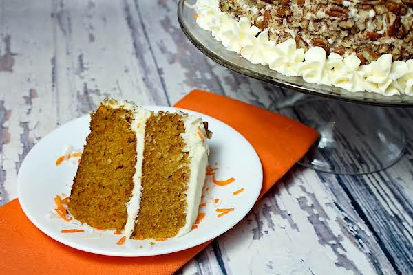A Slice Of The Best Tasting Carrot Cake On A Plate.