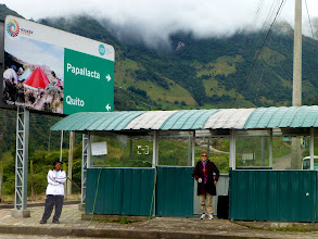 Photo: Waiting at the intersection for a passing bus to Quito