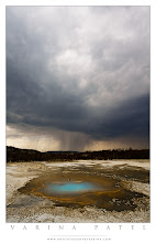 Photo: Pearl in the Storm - Yellowstone National Park, Wyoming  Crazy weather makes the best photos. And fun memories too! ;)  This storm came up on us so fast that we ended up having to run from it. It was a beautiful, sunny day, and we were visiting Norris Geyser Basin. We were out hiking with the kids, and we took a wrong turn on the trail. So, instead of the shorter loop, we ended up on the longer one. And to make matters worse, we mistook the distinctive sound of distant thunder for the rumbling of geysers! We did see clouds moving in, but they didn't look too threatening - until this one appeared. And it was moving FAST! We knew we'd be in trouble if we didn't get moving. We were on a wide-flat plain, and we were carrying our tripods - which start too look a lot like lightening rods when you are surprised by weather like this. :)  So, as the rain started to fall, we told the kids to run for it. We headed for the shelter near the trail head. Jay ran ahead with the kids - and I stopped with my tripod to grab one quick shot before catching up with them. The kids were excited - and the younger ones were a little scared - but we arrived at the shelter just moments before the storm unleashed its fury. They watched wide-eyed as pea-sized hail fell in torrents all around us.  The storm didn't last long, and we were never in great danger - but it was a fun adventure for the kids. At the end of the trip, they all agreed that it was the best part of the whole trip. :)  That said - please stay safe when you are traveling. Beautiful weather can turn bad fast - and it's important to be prepared. Check expected weather conditions before you go out, read your trail maps carefully, know where the nearest shelters are, and watch the skies. Bad weather can be incredibly dangerous.  So, what about you? Have you ever been caught in a storm like this? I'm adding this to The Experience Project collection - so share your stories!  #theexperienceproject   #photographydiscussion