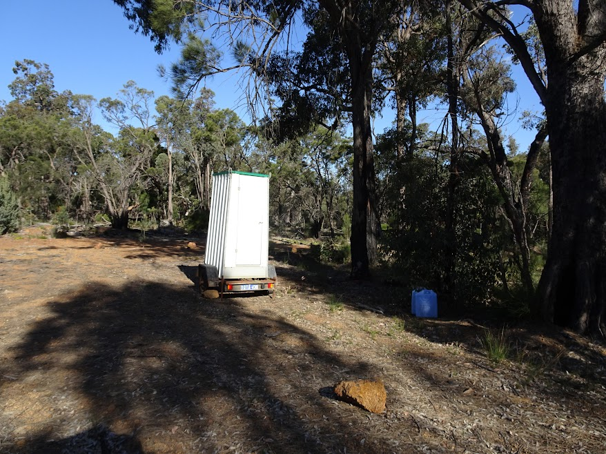 Portable toilet and 2x22L water provided at the temporary campsite (looks nice, doesn't it?)