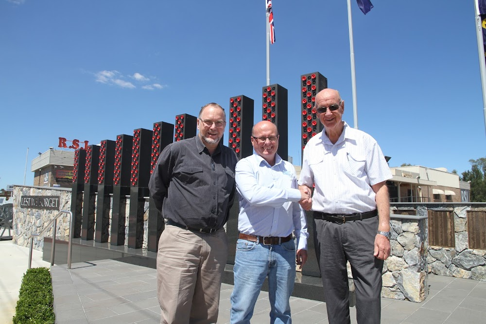 Retiring president of Narrabri RSL Club Barry Stanford, right, congratulates incoming president Bruce O'Hara centre, with club chief executive officer Paul Gordon. The War Memorial behind them is a major achievement by the club in recent years.