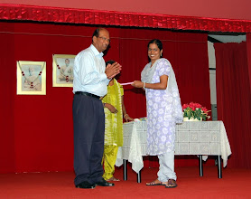 Photo: Mrs Nalini receiving a token of appreciation for TAPAS Reading Program