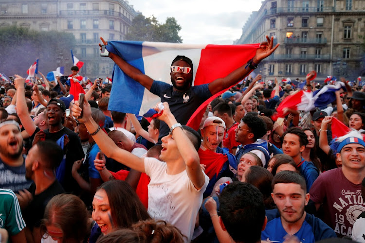 Fans react after France defeated Belgium in the 2018 World Cup semifinal match, in Paris, France, July 10 2018. Picture: REUTERS