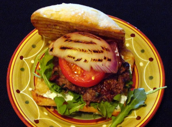 To assemble burger:  Spread Gorgonzola cheese spread over cut side of each bottom...