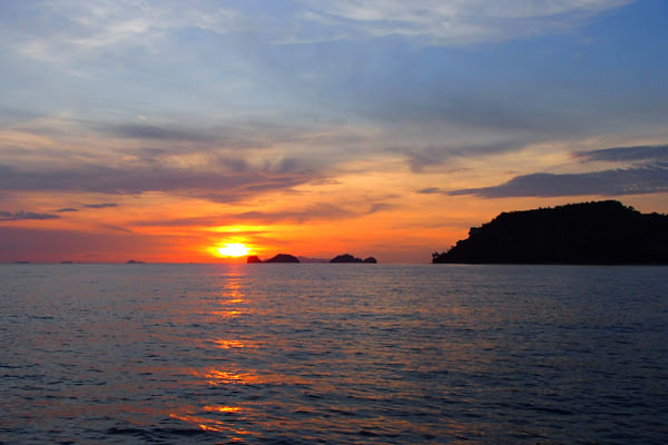 Enjoy the sunset while cruising back to Samui