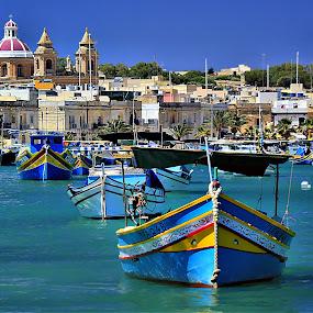 Marsaxlokk Fishing Village Malta Maltese Fishing Boat Luzzu by James Morris - Transportation Boats ( luzzu, fishing, malta, marsaxlokk fishing village, maltese fishing boat, maltese islands )