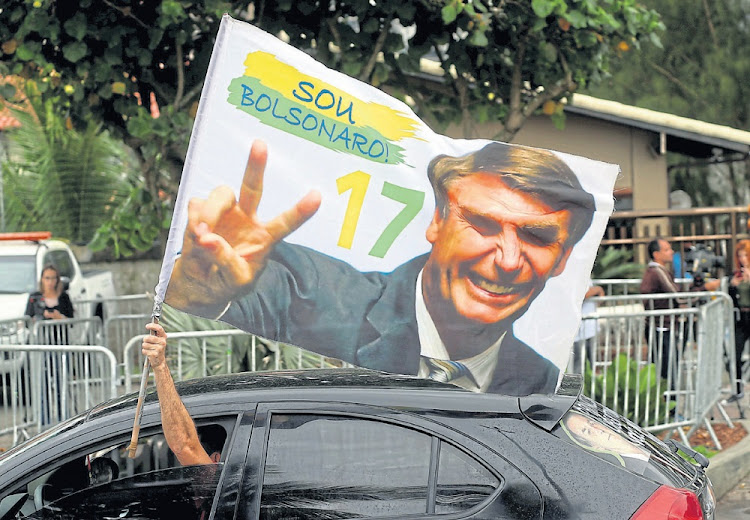 Flagging a problem: The results of populism and xenophobia have infected the political realm in Brazil, which elected Jair Bolsonaro as president. Picture: REUTERS