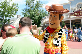 Photo: Andy's toy, Woody stops by and waves to a small child.