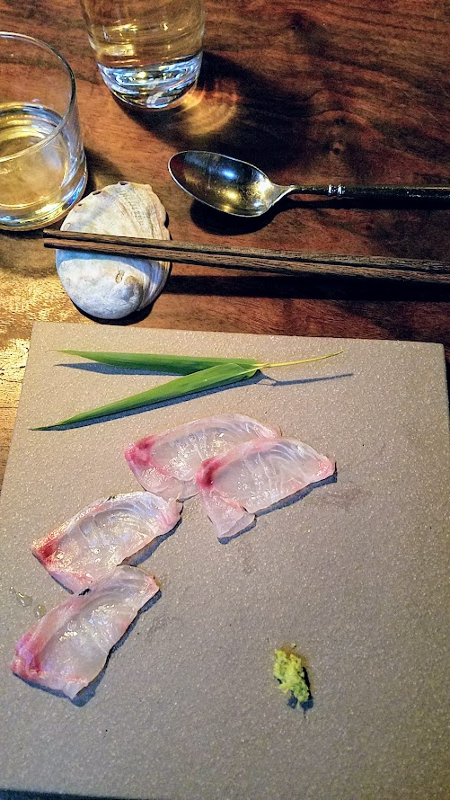 Fukami 19 course dinner of small plates and sushi: Mejina Usuzukuri, thinly sliced opal eye with citrus, salt, and wasabi