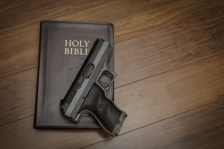 A Pistol and bible.