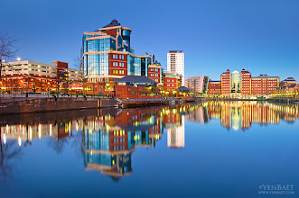 Photo: Twilight Reflections of Residential Buildings at Salford Quays - Manchester, UK.  Another image from the same location as my last post, this time in a different part of the canal.  It's always great to find crystal-clear reflections, and certainly the waters of Manchester Ship Canal, which is nicely enclosed and undisturbed in this part of the docks, provide this nice mirror.  In the same area of the newly-installed MediaCityUK of Salford Quays, one can also find these set of luxury residential buildings, and more high-rise are still on its way to construction. Colorful and predominantly red, they surely are photographic and its glass elements are just what you need to enhance the reflections.