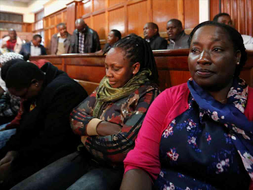 Public Service and Youth secretary Lillian Mbogo Omollo (R) sits in the dock at Milimani Law Courts with other suspects, for charges on the alleged theft of Sh9 billion from the National Youth Service, May 29, 2018. /REUTERS