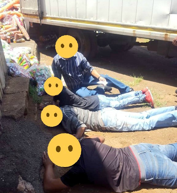 A cash and carry shop owner and three of his employees are arrested in Midway after being found offloading goods from a hijacked truck.