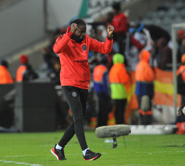 Orlando Pirates' assistant coach Rulani Mokwena celebrates an goal during the Telkom Knockout Last 16 match against Chippa United on October 20, 2018 at Orlando Stadium in Soweto, south west of Johannesburg.