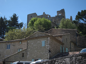 Photo: ... dominated by the Marquis de Sade's ruined castle  ...