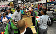 Shoppers jostle to buy products on special at the Mall of Africa in Midrand on Black Friday last year. The Black Friday shopping craze has taken South Africa by storm, with thousands of shoppers enduring long queues for massive discounts. Picture: GALLO IMAGES/FELIX DLANGAMANDLA