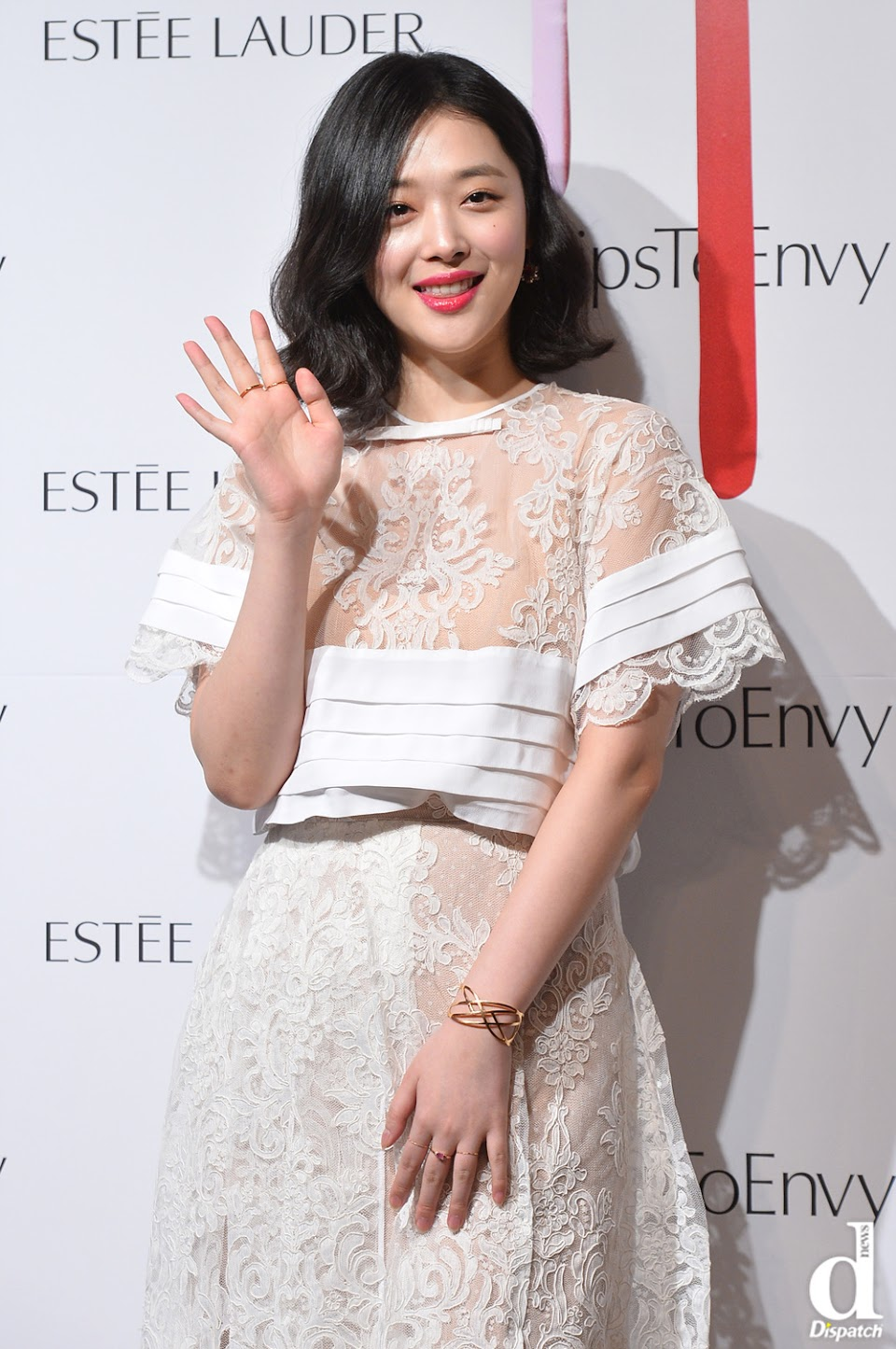 Sulli in white lace dress