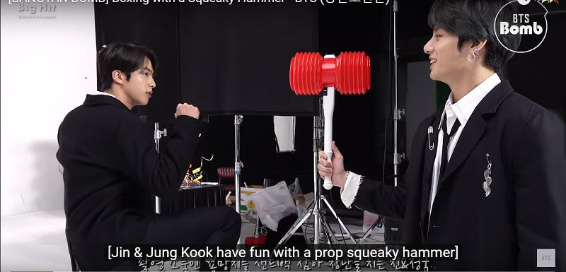 Bts Jungkook and Jin playing with toy hammer