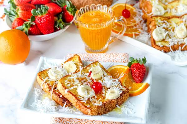 Slices Of French Toast & Orange Syrup On A Plate.