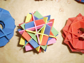 Photo: Here are 15 squares in 5 groups of 3 (colored differently).  Each group of 3 are the midplanes of a different cube.
