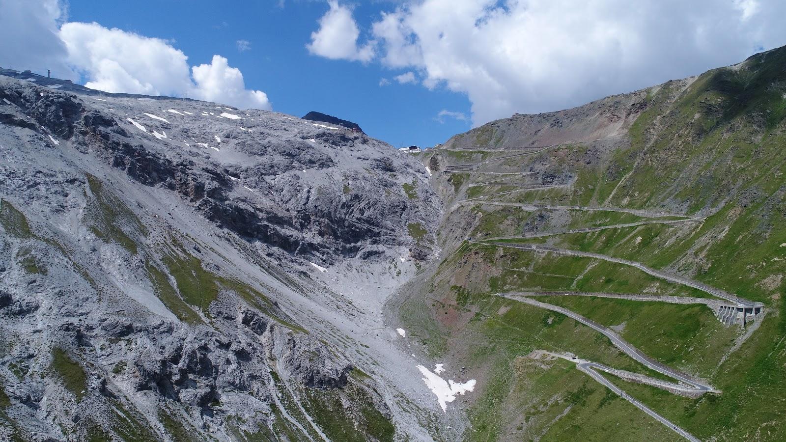 Climbing Stelvio by bike from Prato alla Stelvio - aerial drone photo of tornanti (hairpins) leading to the pass, top of stelvio