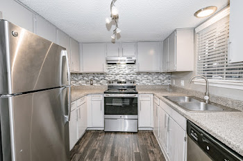 One bedroom floorplan fully-equipped kitchen with tile backsplash and stainless steel appliances