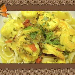 Shrimp In Garlic Saffron Broth.