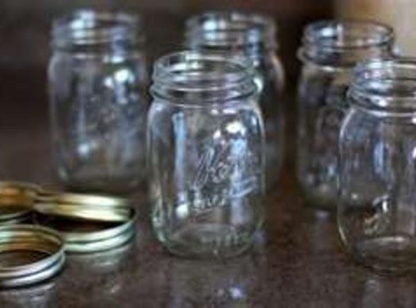 Immediately put into hot quart canning jars. Screw on lids and caps, process according...