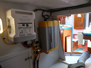 Photo: New battery charger and inverter installed in  quarterberth area.
