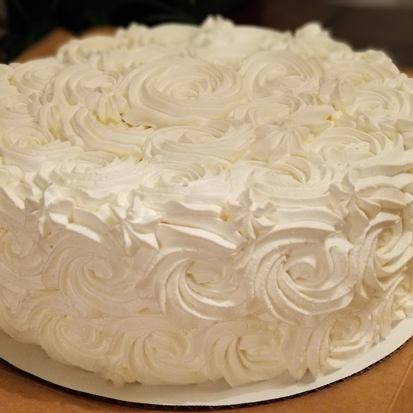 Amazingly delicious Coconut Cake and coconut filling with whipped icing.